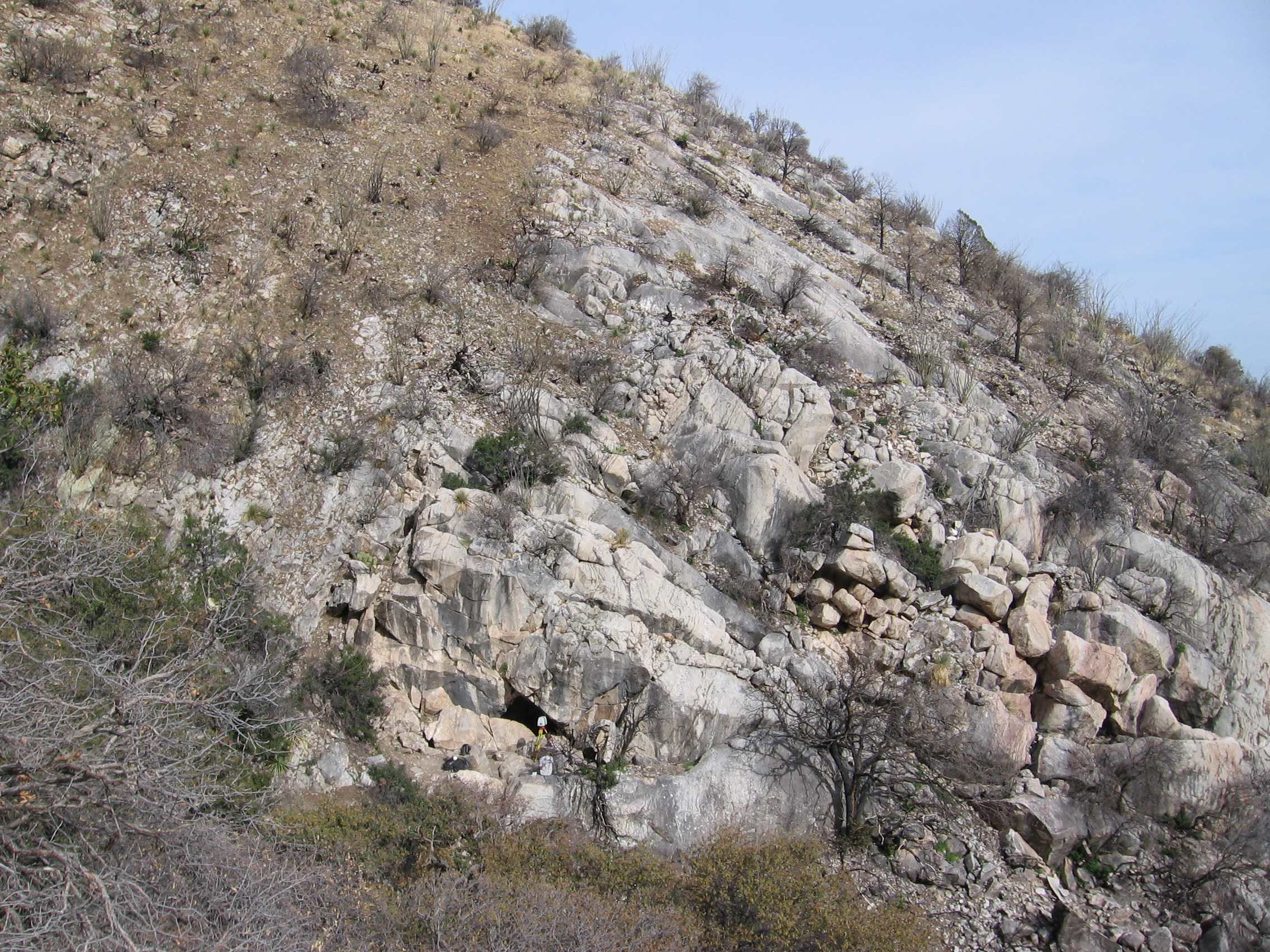Figure 5: Entrance to Coronado Cave. The limestone host rock is clearly bounded on the uphill side by a change in lithology, possibly skarnification because the Huachuca granite is exposed nearby, or perhaps another formation of the Naco Group.
