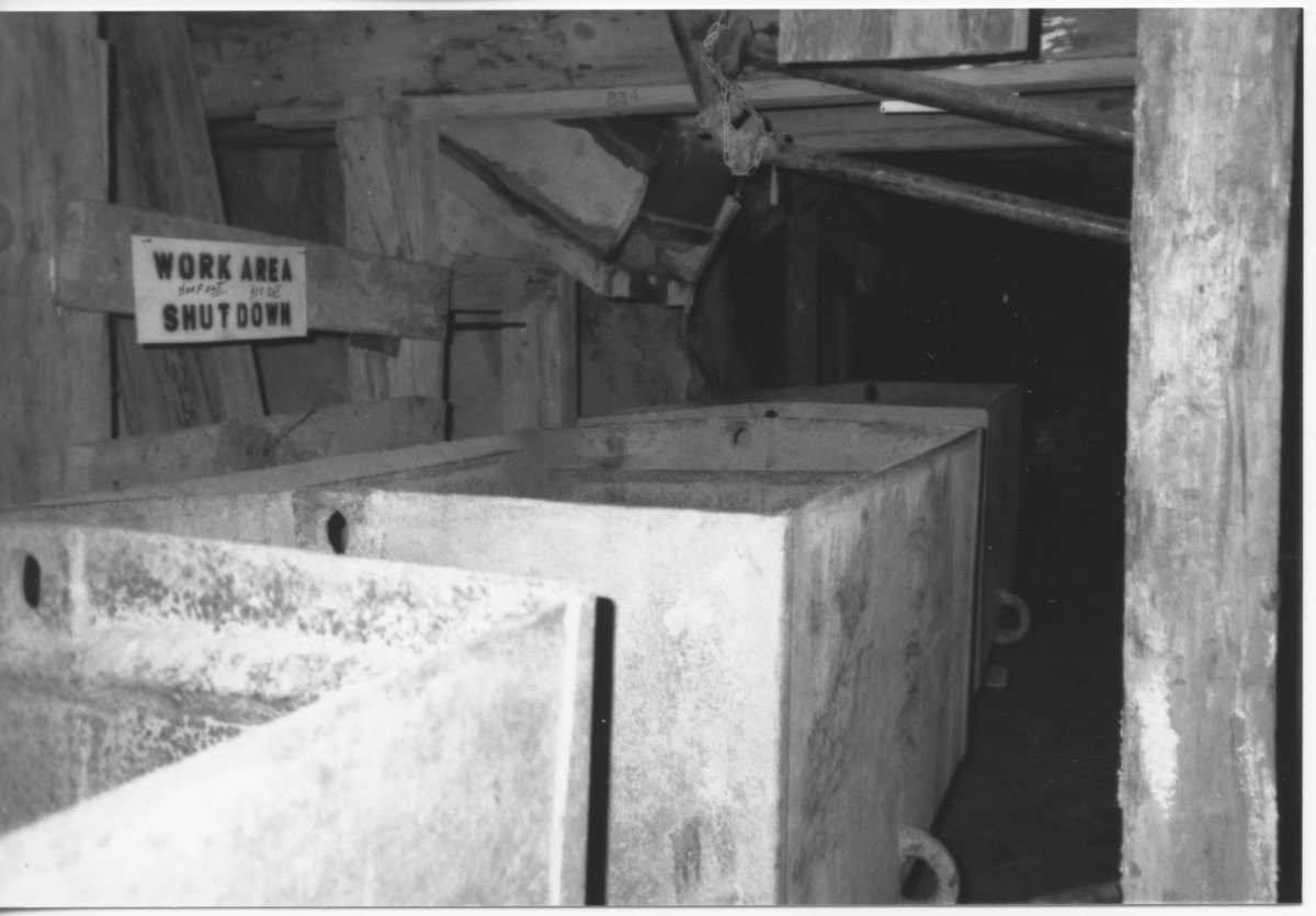 """Figure 3. Results of a search at USGIN for """"admmr photo archive file: Gladstone McCabe 60 52."""" The photograph is of ore cars and timbering at the 850' level in the Gladstone McCabe Mine."""