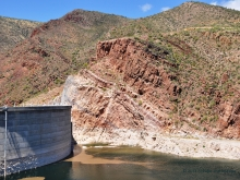 Proterozoic Mescal Limestone beds form the dam abutment and dip into Roosevelt Lake behind Roosevelt Dam