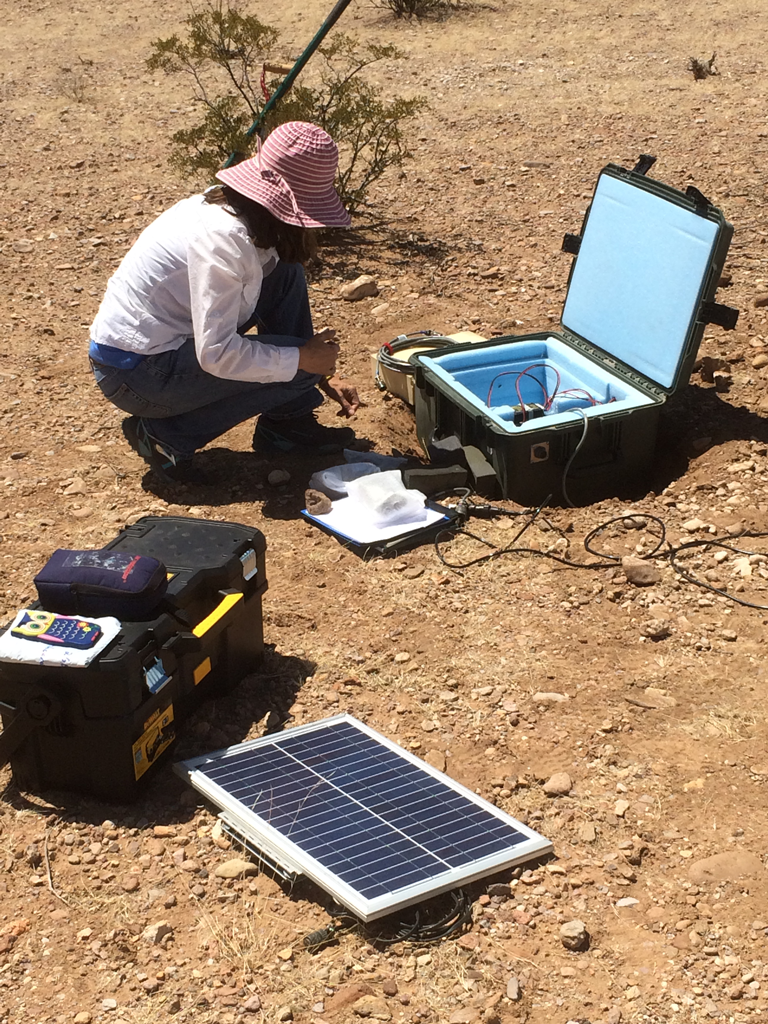 Figure 6. AZGS research geologist Jeri Young deploying a portable seismometer near Duncan, Arizona (8 July 2014).